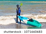 man carrying kayak at sea beach | Shutterstock . vector #1071660683