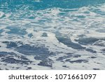waves and foam at the beach...   Shutterstock . vector #1071661097