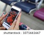 closeup of a smartphone carried ... | Shutterstock . vector #1071661667