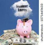 student loan cloud over piggy... | Shutterstock . vector #1071665633