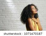 portrait of happy latina woman... | Shutterstock . vector #1071670187