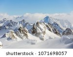 wintertime view from mt. titlis ... | Shutterstock . vector #1071698057