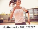 young happy woman running. on... | Shutterstock . vector #1071699227