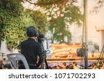 back of cameraman using a... | Shutterstock . vector #1071702293