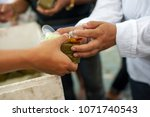 feeding food for beggar poverty ... | Shutterstock . vector #1071740543