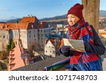 woman traveler holding a map of ... | Shutterstock . vector #1071748703