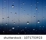 water drops on glass on rainy... | Shutterstock .eps vector #1071753923