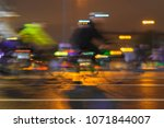 motion blurred image of riding... | Shutterstock . vector #1071844007