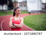 smiling sports woman standing...   Shutterstock . vector #1071880787
