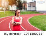 smiling sports woman standing...   Shutterstock . vector #1071880793