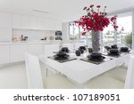 Dining area and kitchen in stylish Australian home - stock photo