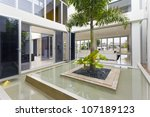 Palm tree and fountain inside luxury home - stock photo