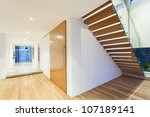 Stylish house interior with staircase - stock photo