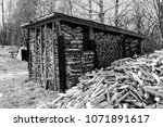 chopped firewood. large... | Shutterstock . vector #1071891617