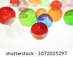 colorful glass balls | Shutterstock . vector #1072025297