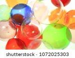 colorful glass balls | Shutterstock . vector #1072025303