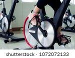 woman  feet exercising cycling... | Shutterstock . vector #1072072133