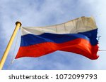old russian flag waves on the... | Shutterstock . vector #1072099793