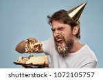 crazy man in a festive cap... | Shutterstock . vector #1072105757