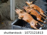barbecued suckling pig grilled | Shutterstock . vector #1072121813