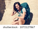 woman traveling with backpack | Shutterstock . vector #1072127867
