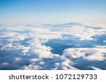 airplane view over the clouds | Shutterstock . vector #1072129733