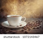 coffee cup and coffee beans on... | Shutterstock . vector #1072143467