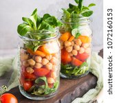 fresh salad lunch with... | Shutterstock . vector #1072160153