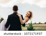 attractive woman in arms of her ... | Shutterstock . vector #1072171937