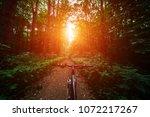 mountain biking down hill... | Shutterstock . vector #1072217267