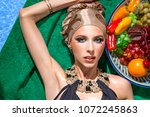 girl in a swimsuit with a plate ... | Shutterstock . vector #1072245863
