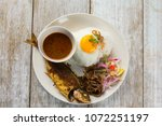 fried fish with rice with... | Shutterstock . vector #1072251197