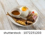 fried fish with rice with... | Shutterstock . vector #1072251203