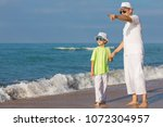 father and son playing on the... | Shutterstock . vector #1072304957