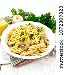 fusilli pasta with mushrooms in ... | Shutterstock . vector #1072309823
