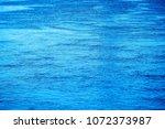 blue water surface  background... | Shutterstock . vector #1072373987