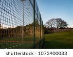 Small photo of Side View Of Metal Fence Surrounding Artificial Multi-Use Pitch