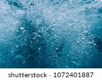 many air bubbles in blue water  ... | Shutterstock . vector #1072401887