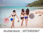 three women on the beach | Shutterstock . vector #1072402067