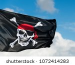 Pirate flag waving on sky