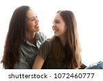 portrait of two sisters next to ... | Shutterstock . vector #1072460777