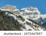 a wintertime view in the swiss... | Shutterstock . vector #1072467857