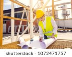 busy female architect working    Shutterstock . vector #1072471757