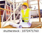 busy female architect working    Shutterstock . vector #1072471763