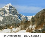 a wintertime view in the swiss... | Shutterstock . vector #1072520657