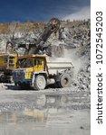 heavy mining excavator loads... | Shutterstock . vector #1072545203