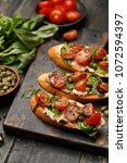 traditional italian bruschetta... | Shutterstock . vector #1072594397