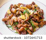 thai style deep fried garlic... | Shutterstock . vector #1072641713