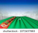 flag of turkmenistan pointing... | Shutterstock . vector #1072657883