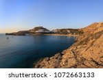 lindos with the castle above on ... | Shutterstock . vector #1072663133
